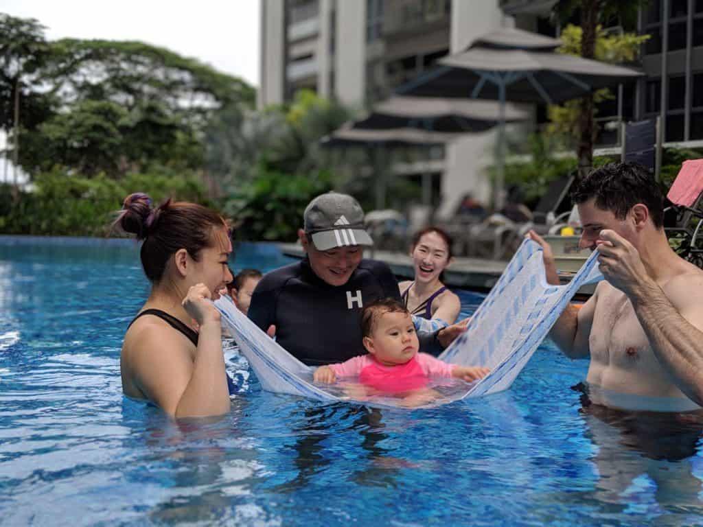 coach steven heng teaching a baby