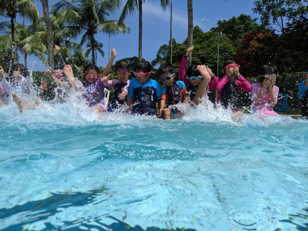 kids enjoying in swimming pool